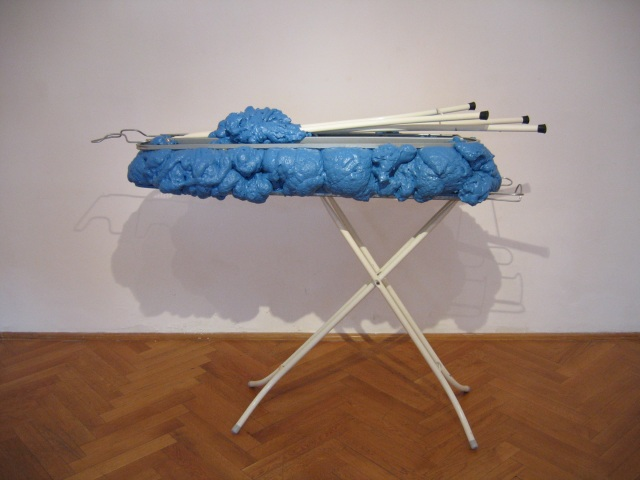 © Wilhelm Roseneder. Hellblaue Erweiterung/Light-blue expansion, 2006. Austrian Cultural Forum. Bratislava, Slovakia 2007. Polyurethan, Acryllack, Metall (Bügelbrett)/Polyurethane, acrylic varnish, metal (Ironing board), 1.10x1.50x60 cm