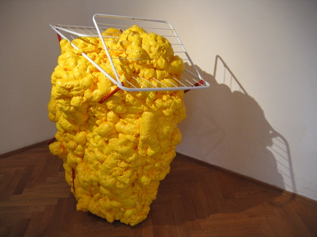 © Wilhelm Roseneder. Gelbe Erweiterung/Yellow expansion, 2006/2007. Austrian Cultural Forum. Bratislava, Slovakia 2007. Polyurethan, verschiedene Materialien, Acryllack auf Metall (Wäschetrockner)/Polyurethane, various materials, acrylic varnish on metal (clothes-dryer), 1.26x1.23x90 cm