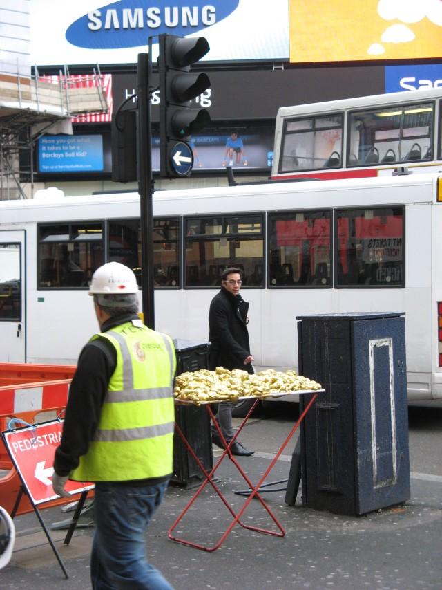 © Renate Egger and Wilhelm Roseneder. Goldene Erweiterung/Golden expansion. Street art project. Piccadilly Circus. London, UK  2010
